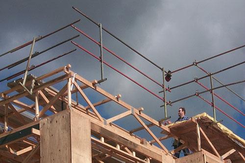 Guard rails for parapet construction