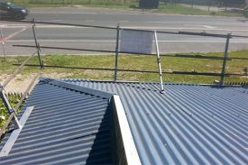 Guard rails for existing metal roofs