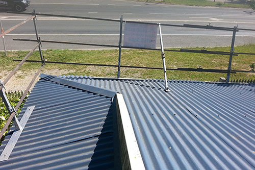 Roof handrails for existing metal roofs